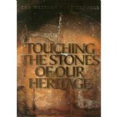 Touching the stones of the heritage